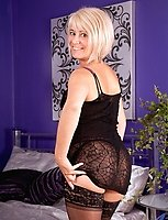 Glamorous blonde milf Dana teases us in her sexy black lingerie in the bedroom