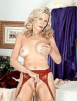 Sweet MILFy blonde kinky stripteasing