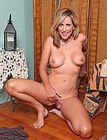 Anilos Jodi West gets horny in her office so she gets naked teases her pussy with a pen
