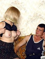 A drunk mature blond in black stockings is fucked in the armchair