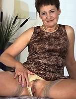 Saucy granny shows her sweet pussy