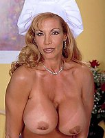 Big boobed beauty in the kitchen
