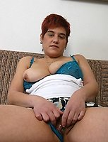 Plump red-haired oldie fucks herself with a dildo
