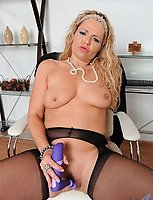Naughty milf secretary fucks her pussy with a purple sex toy