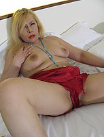 Naughty blonde mature slut playing with her pussy