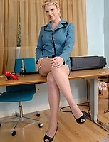Blonde Anilos Cameron Keys stretches her mature pussy with a purple rabbit toy in the office