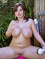 Cute big chested babe gets wet outdoors