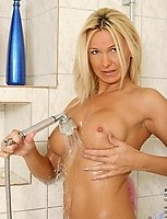 Long haired blonde milf spends extra time cleaning her juicy pink milf pussy