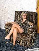 A mature blond fucks and sucks in the armchair